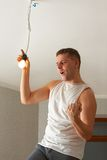 Man making repairs in new flat. Yeah! It's done! Royalty Free Stock Photo