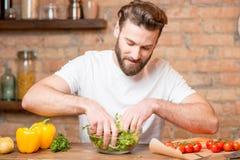 Man making salad stock photos