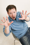 Man making scary gesture Stock Photos