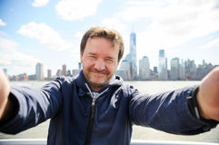Man making selfie with Manhattan skyscrapers in New York City Royalty Free Stock Photography
