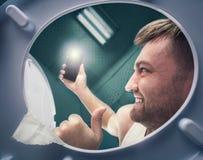 Man making selfie near the toilet bowl Royalty Free Stock Photos