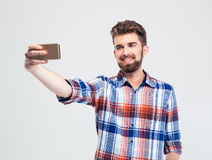 Man making selfie photo on smartphone Stock Image