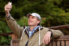 Man making selfie using mobile phone Stock Photo