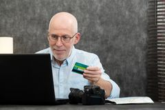Man making shopping on web and pay with credit card royalty free stock photography