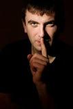 Man making silence gesture Royalty Free Stock Photos