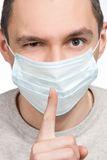 Man making silence sign  in protective mask Stock Photo