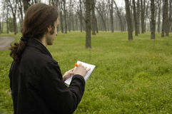 Man making sketch's. Artist with pencil and paper making sketch's in the park Stock Photography
