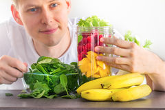 Man making smoothie Stock Image