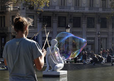 Man making soap bubbles royalty free stock photo