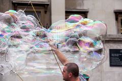 Man making soap bubbles Royalty Free Stock Image