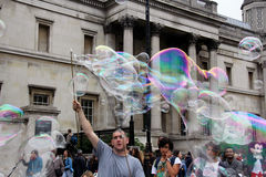 Man making soap bubbles Royalty Free Stock Photography