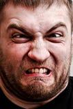 Man making stupid face. Portrait of strange man making stupid angry face stock photo