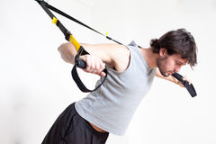 Man making suspension training Royalty Free Stock Images