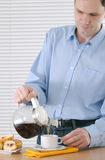 Man making tea Stock Photography