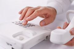 Man making a telephone call on a landline Royalty Free Stock Image