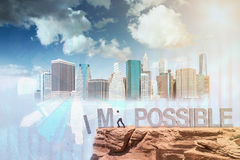 Man making things possible. Businessman pushing letters I and M from the rock. Word 'possible' standing sound. New York and sky at background. Concept of Royalty Free Stock Photo