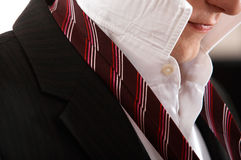 Man is making a tie knot Royalty Free Stock Images