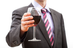 Man making a toast. Gentleman making a toast with a glass of red wine Stock Image
