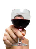 Man making a toast with glass of red wine Royalty Free Stock Images