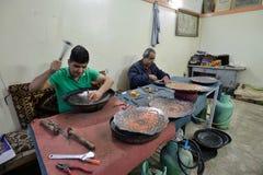 Man making traditional iranian souvenirs royalty free stock photo