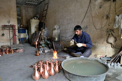 Man making traditional iranian souvenirs Stock Photos