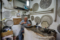 Man making traditional iranian souvenirs Stock Images