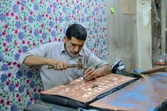 Man making traditional iranian souvenirs royalty free stock photos