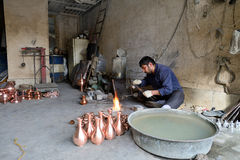 Man making traditional iranian souvenirs Royalty Free Stock Photo