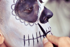 Man making up as a mexican sugar skull Royalty Free Stock Photography