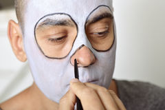Man making up himself to perform a character Stock Image