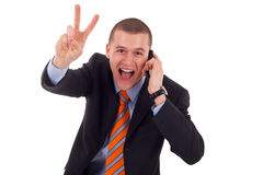Man making victory sign on phone Stock Image