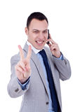 Man making victory sign on phone Royalty Free Stock Photography