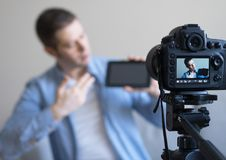 Man making video blog about tablet pc. Stock Photos