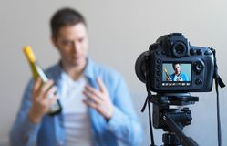 Man making video blog about wine. Royalty Free Stock Images