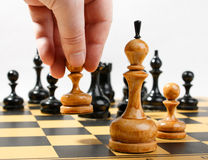 Man making the white pawn move in a chess game Stock Photos