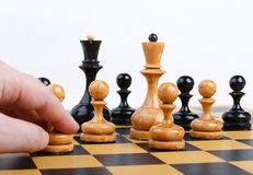 Man making the white pawn move in a chess game Royalty Free Stock Photo