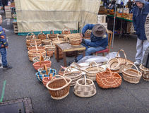 Man making wicker baskets Stock Photo