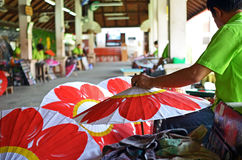 Man making wooden paper umbrella. Picture of man painting umbrella taken at umbrella factory in Chiang Mai Thailand Royalty Free Stock Image