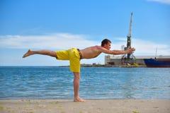 Man making yoga exercises Royalty Free Stock Photos
