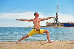 Man making yoga exercises Stock Photos