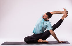 Man is making yoga Royalty Free Stock Photos