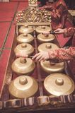Man with Malay songket costume playing traditional music instrum. Ent called Gamelan. selective focus shot Royalty Free Stock Photos