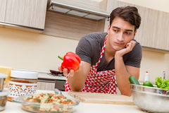 The man male cook preparing food in kitchen Stock Image