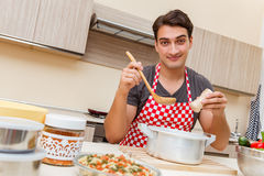 The man male cook preparing food in kitchen Stock Photography