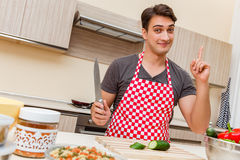 The man male cook preparing food in kitchen Stock Photos