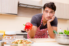 The man male cook preparing food in kitchen Royalty Free Stock Photography
