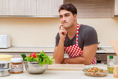 The man male cook preparing food in kitchen Stock Images