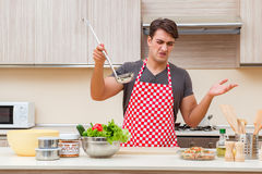 The man male cook preparing food in kitchen Stock Photo