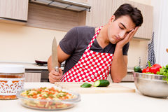 The man male cook preparing food in kitchen. Man male cook preparing food in kitchen Stock Photo