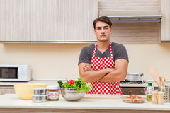 The man male cook preparing food in kitchen Royalty Free Stock Image